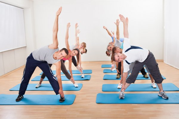 Pilates-class-exercising-in-a-gym[1]